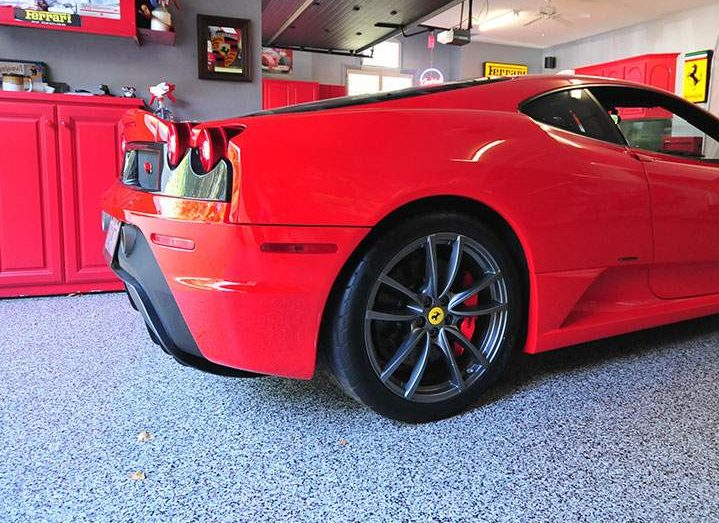 Ferrari sitting atop an epoxy floor coating in garage