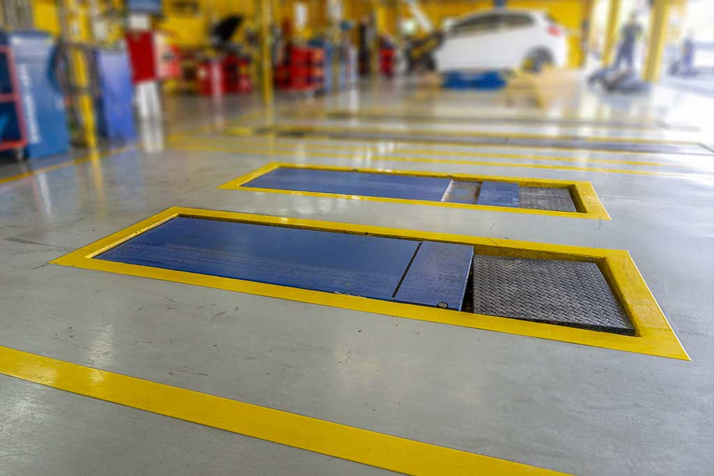 Epoxy flooring system in an auto body garage