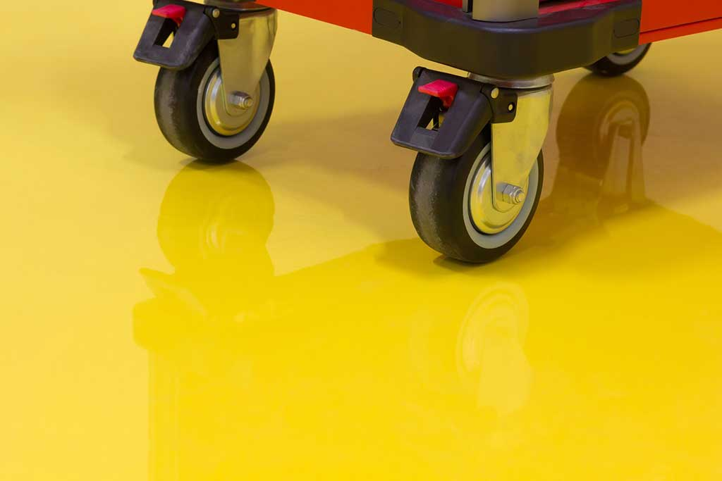 Yellow epoxy flooring with cart on top