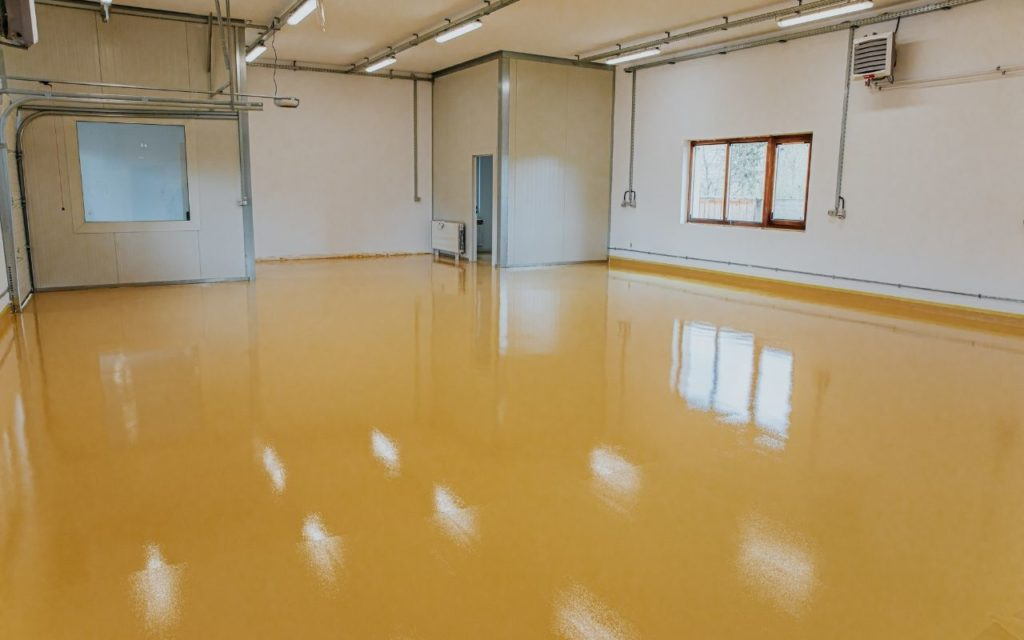 Yellow Premium multi-coat epoxy in garage
